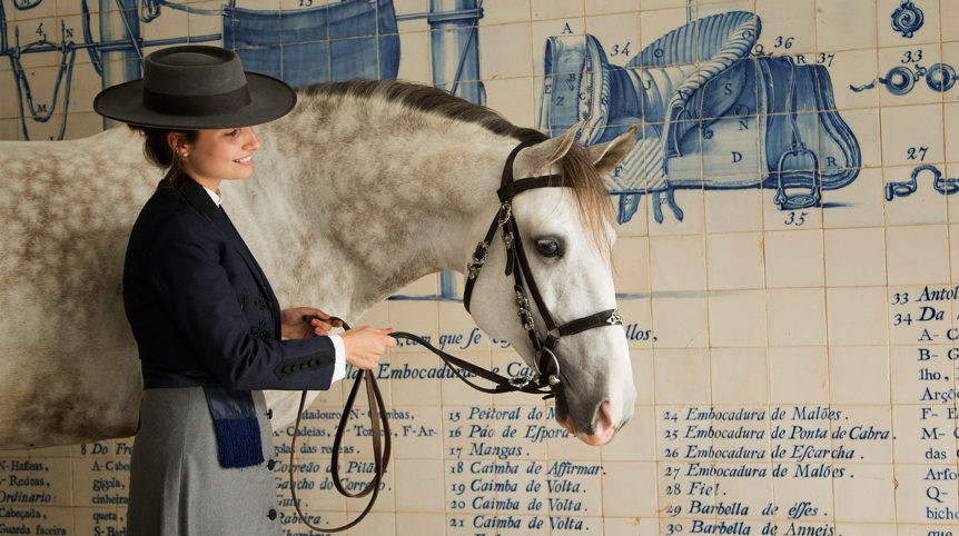 Horse woman's portrait with Lusitano stallion against azulejos