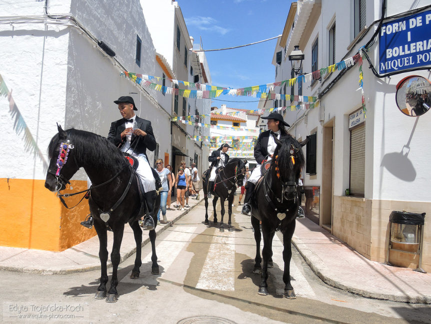 Riders on their black stallions in Menorca during fiesta